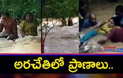 <p>Car washed away in flood waters, two rescued at gannavaram - bsb<br /> &nbsp;</p>